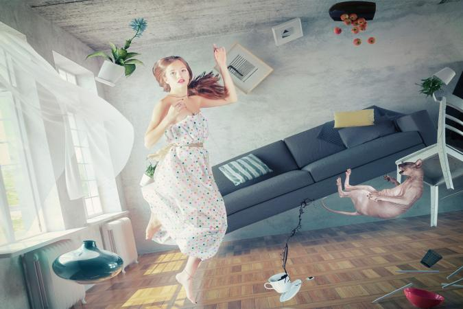 Woman With Decorative Objects In Room