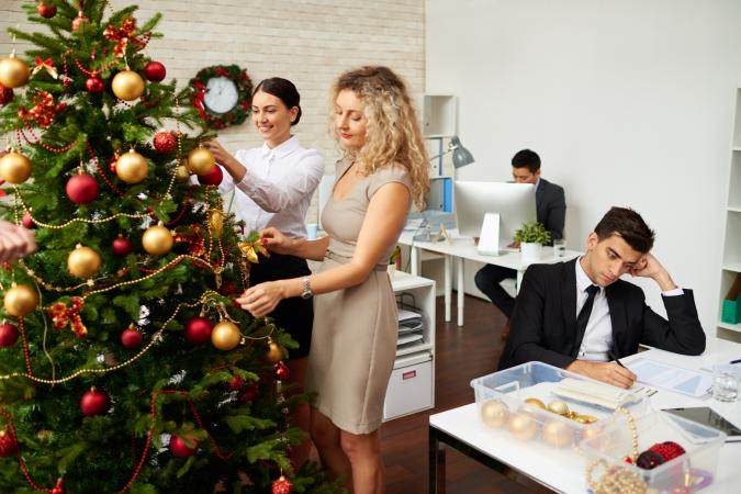 office christmas decoration themes winter wonderland image of office workers decorating christmas tree office decorating themes lovetoknow