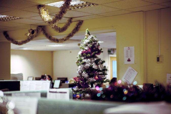 Metallic tinsel and garland on office Christmas tree