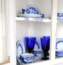 Blue and white china in cabinet