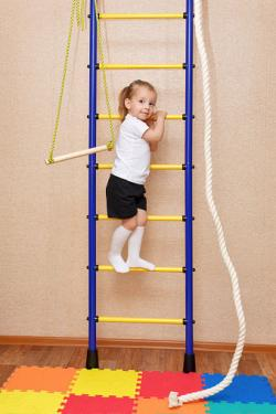 Kids climbing ladder with mat below