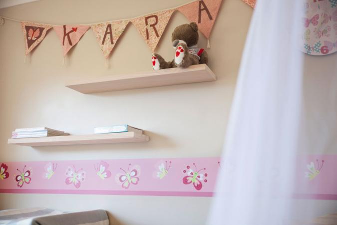 Butterfly wallpaper border in girl's room