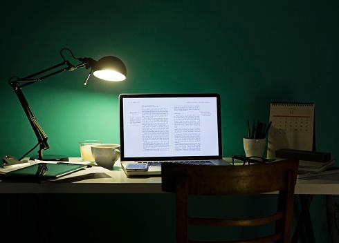 desk illuminated by desk lamp