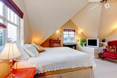 bedroom with cream color vaulted ceiling