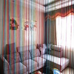 Multicolored string lines in room