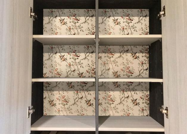 Patterned paper inside cabinet wall