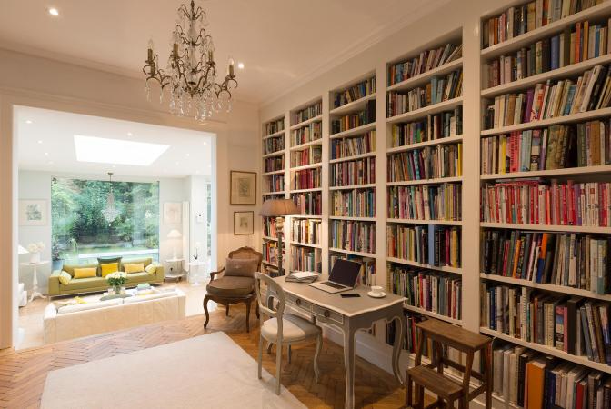 elegant room with books on bookshelves
