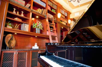 room with bookshelves and piano