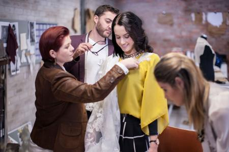 dress designer measuring woman