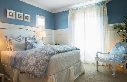 Cozy Blue Bedroom with Flower Linens