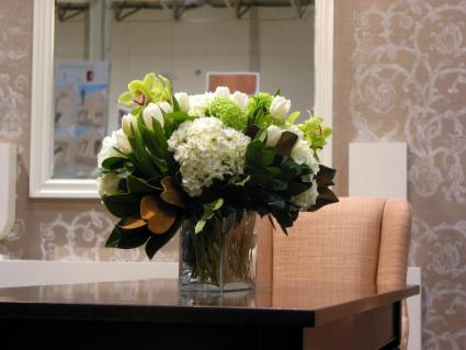 Table-with-flowers-and-wall.jpg