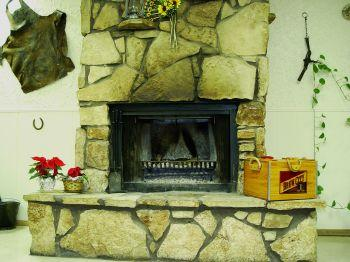 Stone fireplaces provide radiant heat.