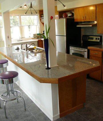 Kitchen featuring granite kitchen countertop.