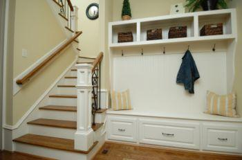 Mud room tucked beside back staircase