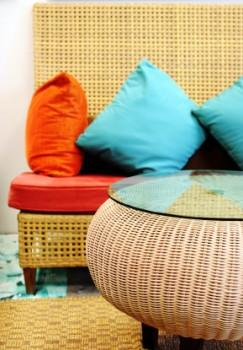 Wicker furniture and colorful pillows