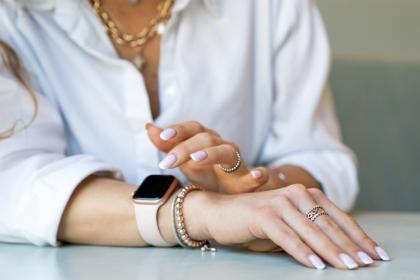 woman with smart watch and bracelets at desk
