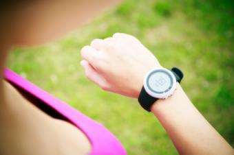 Woman looking at digital watch