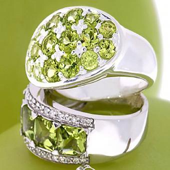https://cf.ltkcdn.net/jewelry/images/slide/209094-850x850-Peridot-and-Citrine-ring.jpg