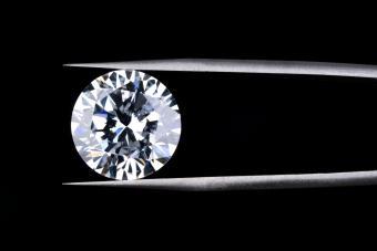 Macros shot of tweezers holding diamond