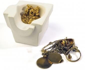 old gold jewelry and crucible