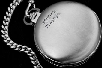 Latitude and Longitude engraved on a watch