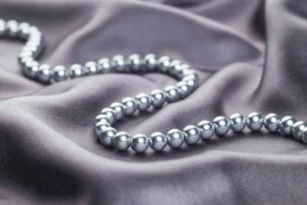 Necklace of pearls on gray satin