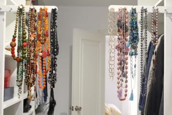 Necklaces hanging on rack in closet