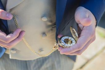 Man Holding Pocket Watch