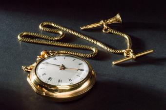 Gold pocket watch and chain