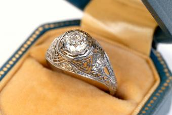antique diamond ring with the diamond set in a platinum basket setting