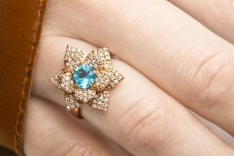 Beautiful golden ring with blue zircon gem