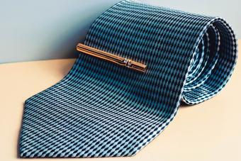 Tie roll with golden tie clip