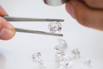 Gemologist inspecting diamonds using loupe
