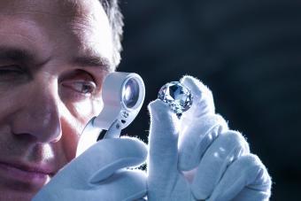 Jeweller inspecting replica diamonds