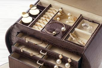 Open brown leather jewelry box