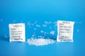 Desiccant or silica gel indifferent packaging and spread on blue background