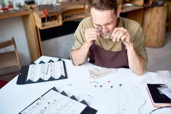 Man Appraising Jewelry in Shop
