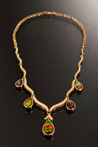 Gold chain necklace with precious gems