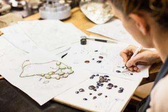 Woman designing jewelry in workshop