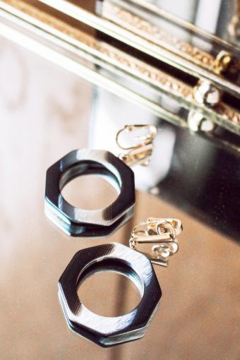 Fashionable Earrings On Mirror Tray