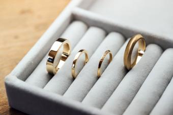 A collection of handcrafted golden rings on display