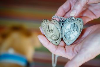 woman showing photographs in locket