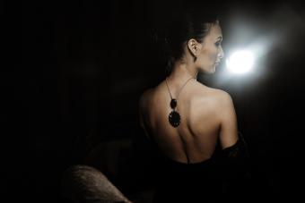 woman wearing beautiful jewelry in a dark room