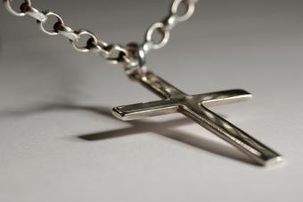 Silver crucifix on necklace chain