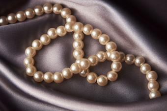 pearl necklace on silky fabric