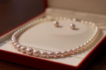 pearl necklace and earring stored in lined box