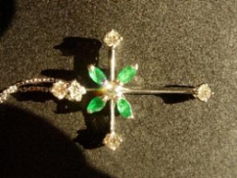 Emerald and diamond cross necklace