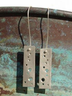 A pair of sterling silver tag earrings