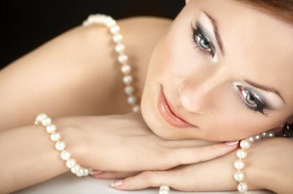 Woman wrapped in pearls