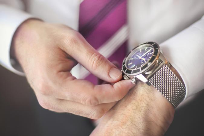 man setting watch
